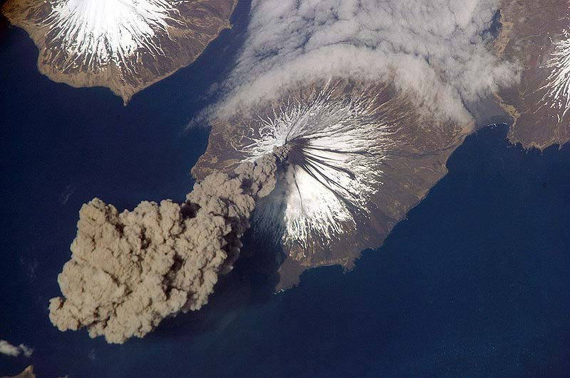 Space a giant plume of smoke bellows out from the ice capped volcanic