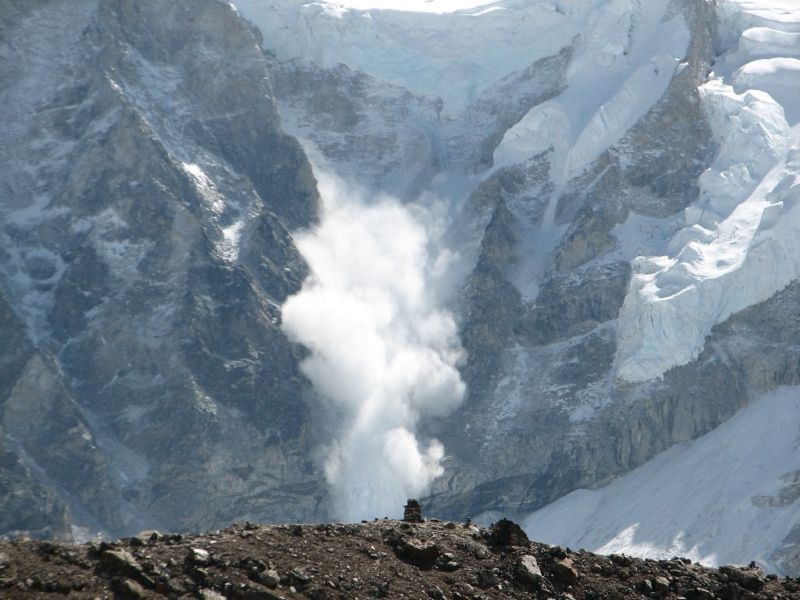 This photo shows an epic avalanche in action on Mt Everest. Huge amounts of snow tumble down the mountain at rapid speeds.