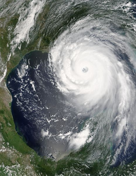 This photo shows a satellite image of the destructive Hurricane Katrina as it makes its way over both the ocean and the coast of the USA.