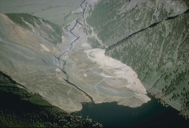 This dramatic photo shows the impact of a massive landslide that has slid much of the way down a large hill.