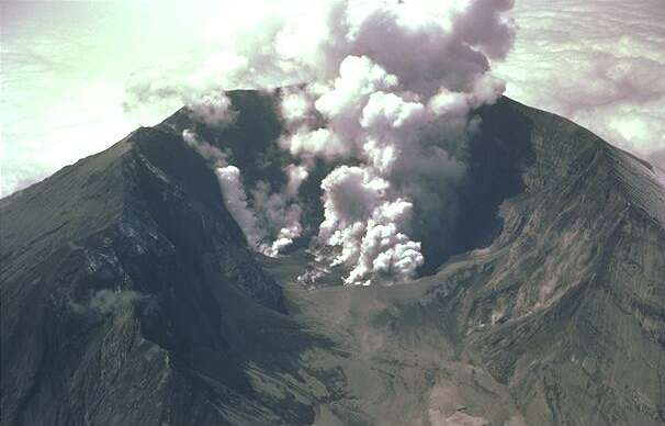Smoke bellows from a volcano crater as an eruption takes place. This kind of volcanic activity can be quite common on active volcanoes around the world.