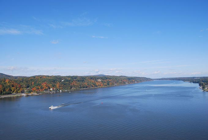 This image shows the Hudson River which runs through eastern New York. The photo was taken from a footbridge that crosses the river.