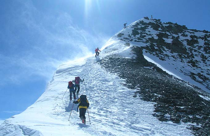 Five climbers can be seen in this photo as they make their way up K2, the second tallest mountain in the world and one the most difficult to climb. The peak of K2 is 8611 metres (28251 feet) above sea level.