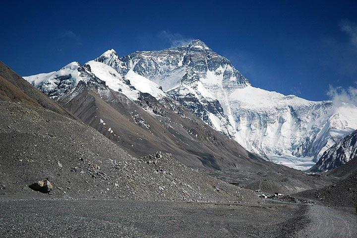 This photo shows the impressive peak of Mt Everest, the tallest mountain in the world. The image is taken from Rongbuk valley, close to base camp and the Rongbuk glacier. Found on the border of Nepal and Tibet, Mt Everest reaches an amazing height of 8848 metres (29029 feet).