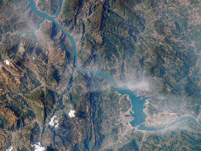 Located in China, the Yangtze River is one of the longest rivers in the world, reaching a length of around 6300 kilometres (3917 miles). This high altitude photo of the Yangtze River shows where the Three Gorges Dam is located.