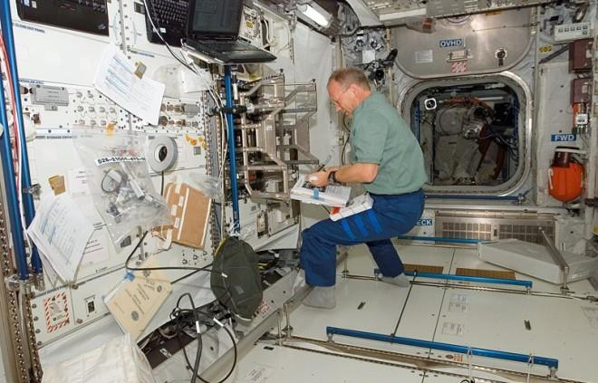 This photo shows an astronaut researching in the zero gravity environment of space.