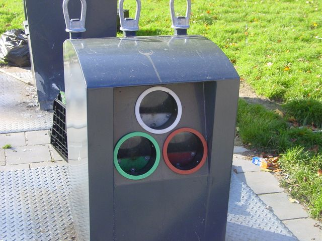 This picture shows a glass recycling bin at a neighborhood collection point for recyclable materials.