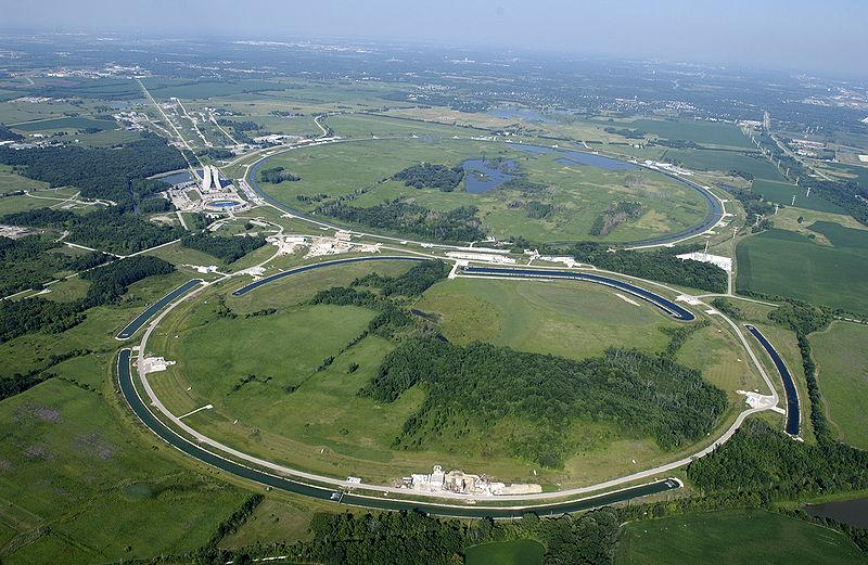 This photo shows the Fermi National Accelerator Laboratory. The Main Ring and Main Injector can easily be seen from the air, as well as the circular ponds that dissipate waste heat from the various equipment.