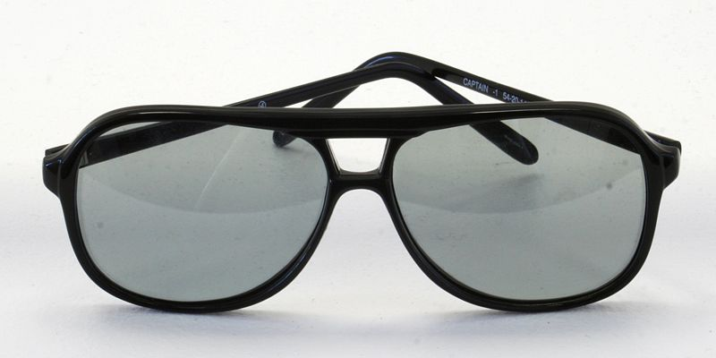 These polarized glasses offer high protection from UV rays produced by the sun. The sunglasses sit facing forward on a white table.