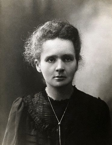 This is a black and white photo of Marie Curie, a scientist famous for being the first person to receive two Nobel Prizes as well as her extensive work on radioactivity.