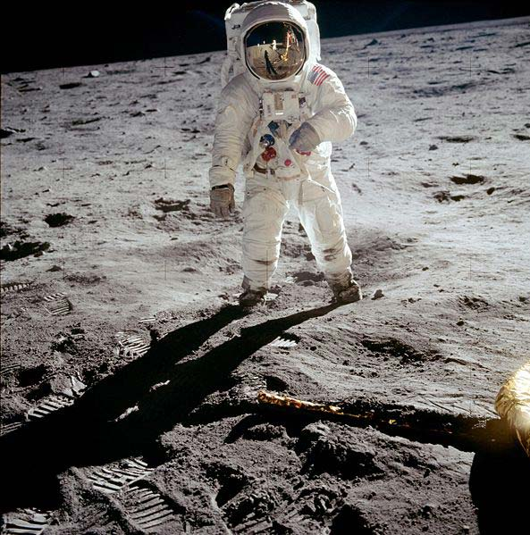 A NASA photo of American astronaut Buzz Aldrin as he walks on the moon in his spacesuit.