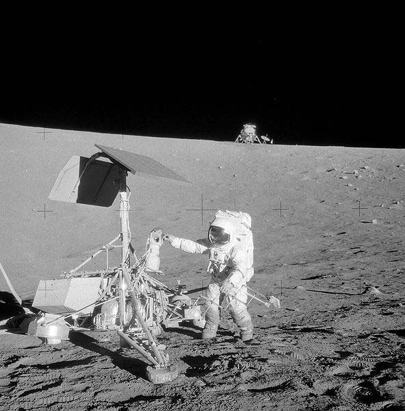 An iconic photo of an astronaut as he does field work on the moon.