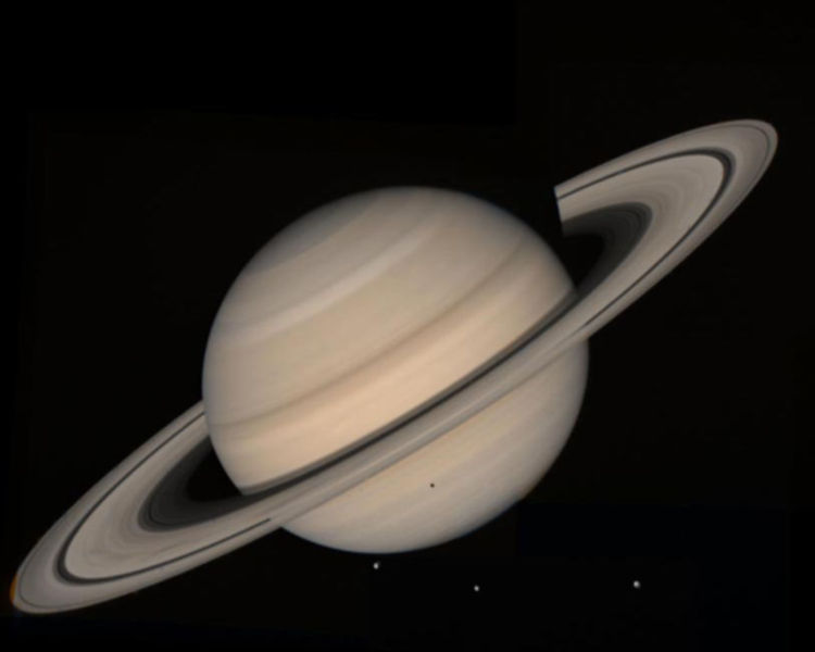 A beautiful photo of Saturn taken by Voyager 2 which gives a clear view of the planets amazing ring systems and even some of its moons as they orbit in front of the gas giant.