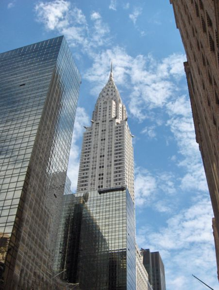 This photo looks up at the famous Chrysler Building in New York. Standing at an impressive 319 metres (1,047 ft) in height, the Chrysler Building was completed in May 1930. It features an Art Deco style of architecture and is widely thought of as being one of New York's most recognizable buildings.