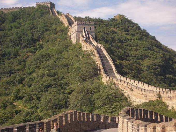 This photo shows a section of the Great Wall of China at Mutianyu. The Great Wall of China is an amazing man made structure that stretches for nearly 9000 kilometres (5500 miles).