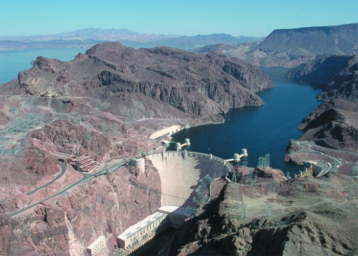 This excellent photo helps capture the incredible size of the Hoover Dam. Completed in 1936, the Hoover Dam is located in the Black Canyon of the Colorado River on the border of Arizona and Nevada in the USA.