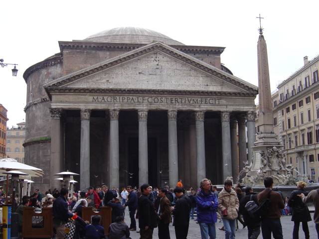 The Pantheon in Rome, Italy was built over 2000 years ago as a temple for the gods of Ancient Rome. This photo shows a number of tourists and visitors enjoying the sites around the temple which can be seen in the image background.