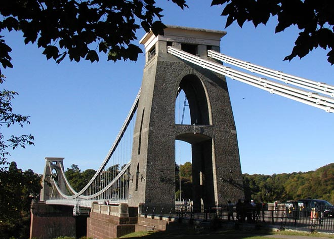 This photo shows a common type of bridge known as a suspension bridge. The Clifton Suspension Bridge stretches over the River Avon in Bristol, England. It was designed by a famous civil engineer named Isambard Kingdom Brunel.