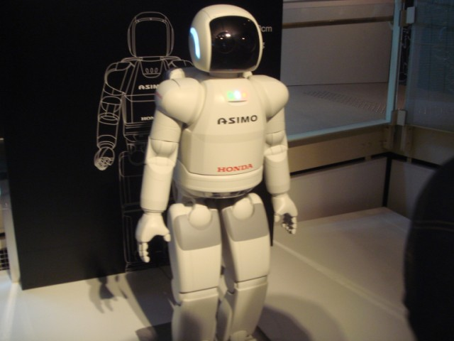 This photo shows perhaps the most advanced humanoid robot in the world, the ASIMO robot created by Honda. ASIMO has undergone a number of revisions through the years and this model is even more advanced than previous models, capable of undertaking a number of commands while being aware of its environment.