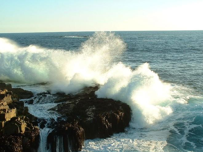 The waves crash ferociously into the rocks along a coastline in Chile. The unforgiving Chilean coastline waves send water flying in all directions.