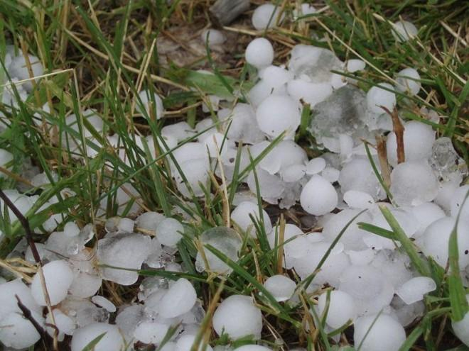 This photo shows a large bunch of hail stones not long after a particularly heavy hail shower. The hail stones are very big, capable of causing damage to property and even unlucky people caught outside during the storm.