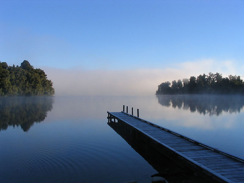 This photo manages to capture the beauty of the morning mist that lurks around Lake Mapourika in New Zealand. A peer stretches deep into the calm waters that fill the lake and hazy trees can be seen across the other side.